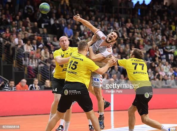 Vid Levc Darko Stojnic of RK Velenje Petar Nenadic of Fuechse Berlin and Matjaz Brumen of RK Velenje during the game between Fuechse Berlin and RK...
