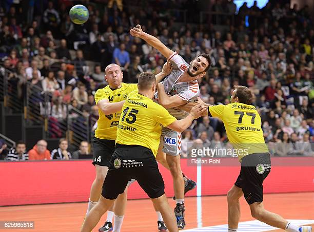 Vid Levc Darko Stojnic of RK Velenje Petar Nenadic of Fuechse Berlin and Matjaz Brumen of RK Velenje during the game between Fuechse Berlin and RK...