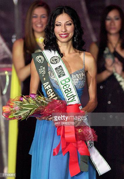 Vida Samadzai of Afghanistan smiles after receiving the 'Beauty For A Cause' award during the 2003 Miss Earth contest in Manila 09 November 2003...