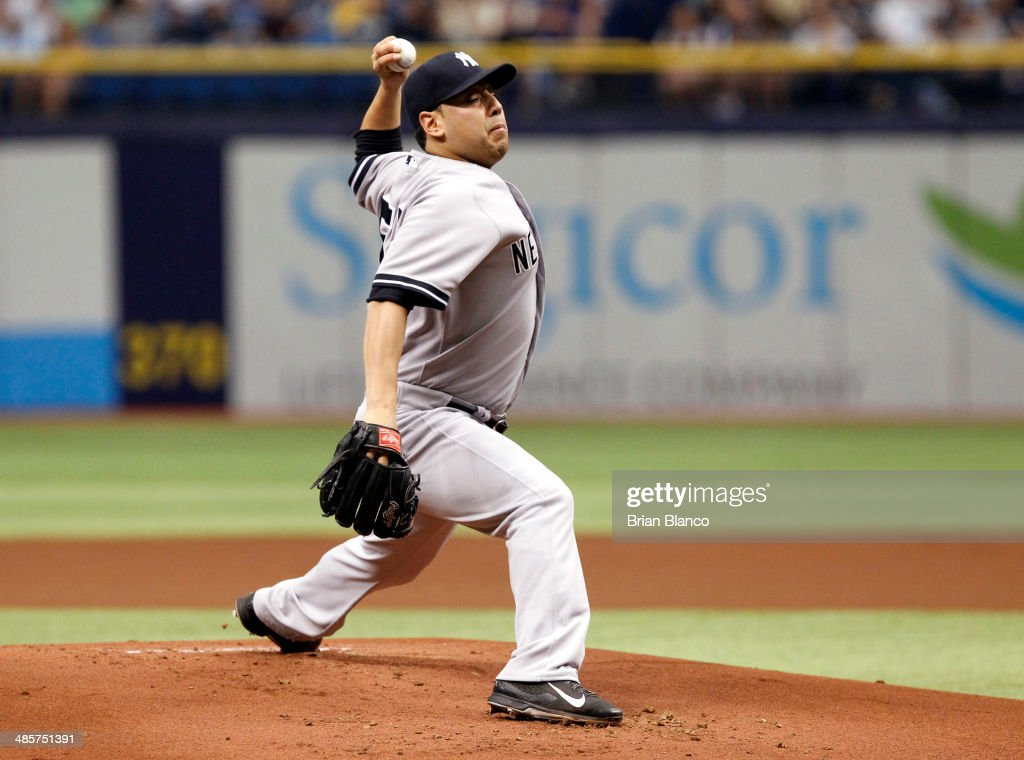 Vidal Nuno #57 of the New York Yankees pitches during the first inning of a game against the Tampa Bay Rays on April 20, 2014 at Tropicana Field in St. Petersburg, Florida.