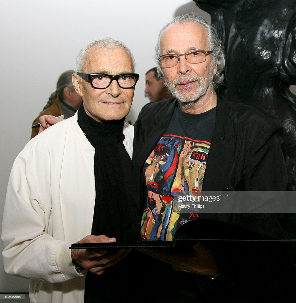 Vidal Sassoon (L) and Herb Alpert attend Herb Alpert's Black Totems Exhibition and book signing on July 22, 2010 in Los Angeles, California.