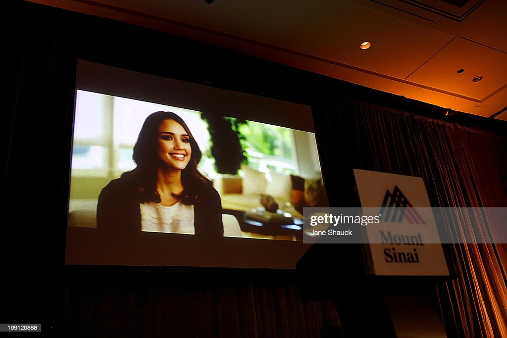 A video about Jessica Alba's experience with chemicals and how she started The Honesty Co. plays at the Champion For Children Award Ceremony and Luncheon honoring Jessica Alba at Hyatt Regency Greenwich on May 20, 2013 in Greenwich, Connecticut.