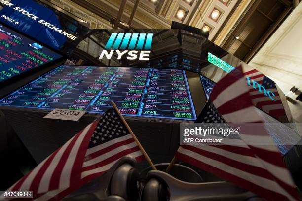 A video board and American flags on the floor at the closing bell of the Dow Industrial Average at the New York Stock Exchange on September 14 2017...
