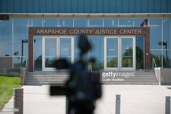 A video camera is aimed at the front entrance of the Arapahoe County Justice Center as the announcement of the sentence in the James Holmes Aurora...