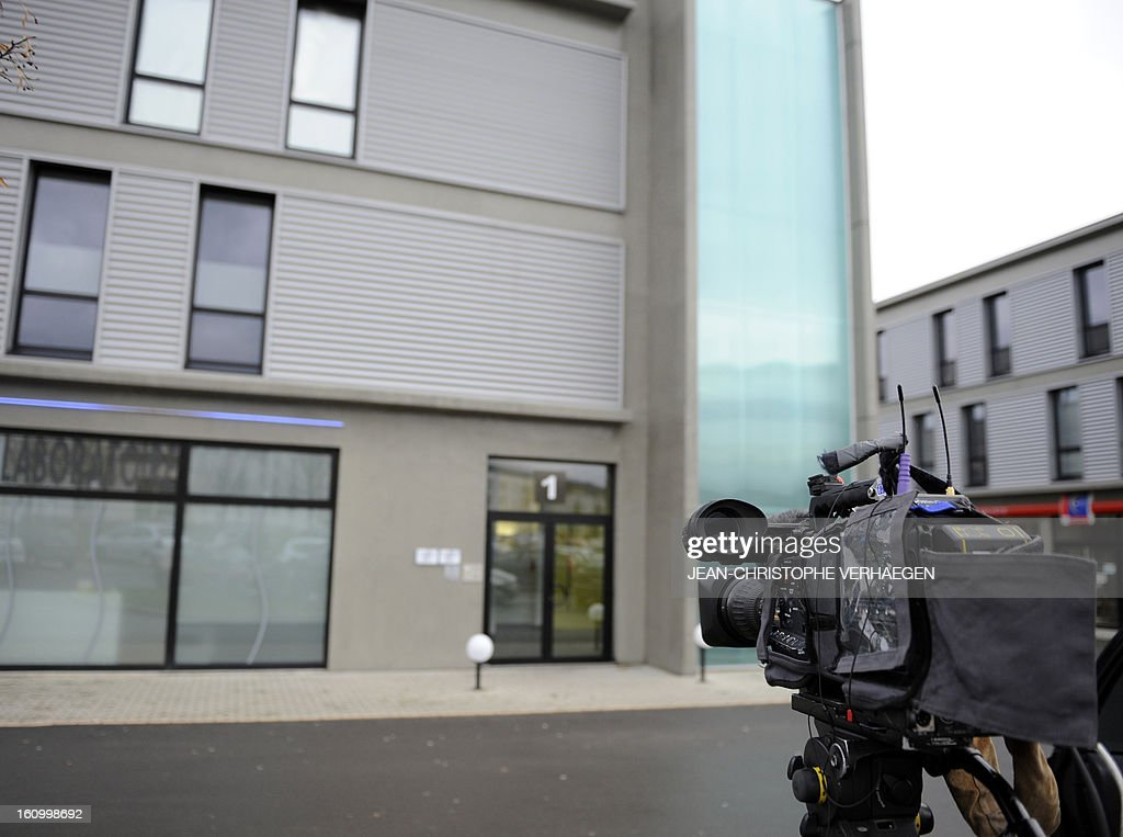 A video camera is aimed towards a door to the Comigel headquarters on February 8, 2013 in Metz, eastern France. The French food company that supplied frozen lasagne found to contain up to 100 percent horsemeat to British supermarkets today shut down its website and declined to answer media enquiries. Comigel, based in the northern city of Metz, supplies frozen meals to supermarket chains and other clients in 15 countries, with Germany, the Netherlands, Belgium and Scandinavia the main markets, according to industry websites. AFP PHOTO / JEAN-CHRISTOPHE VERHAEGEN