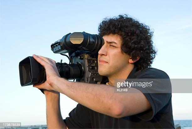 Hombre con cámara de Video