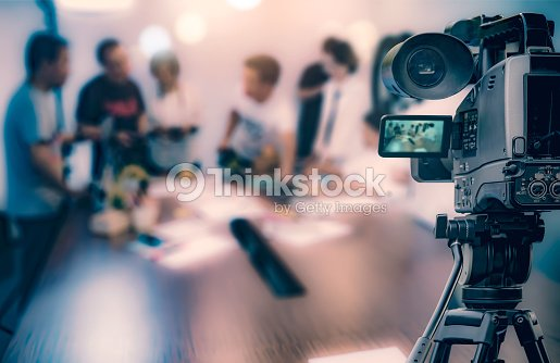 Video camera taking live video streaming at people working background : Stock Photo