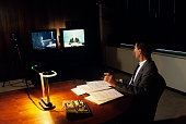 Video conference with cameras and monitors