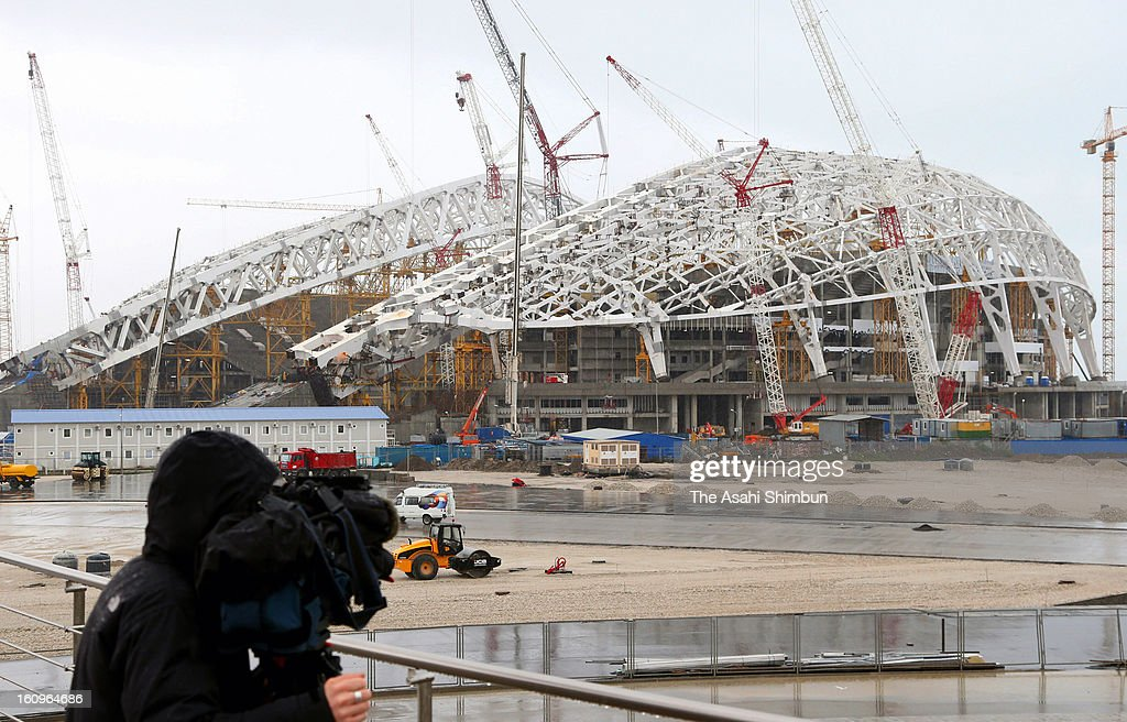 A video crew films Sochi Olympic's main stadium under construction on January 30, 2013 in Sochi, Russia. Sochi Winter Olympics begins on February 7, 2014.