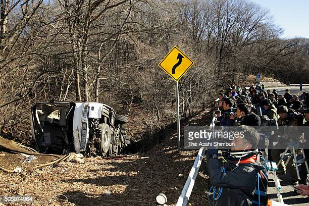 video crews and photographers gather at anight ski bus accident site killing at least 14 people and injuring 27 on January 15 2016 in Karuizawa...