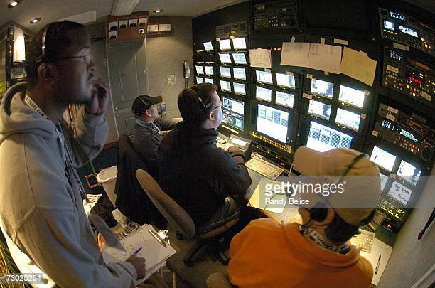 TV video editors review game coverage to extract replays for inside a mobile production truck during the 2007 NBA DLeague Martin Luther King Jr...