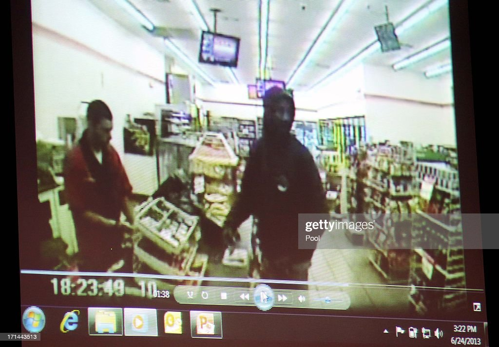 A video entered as evidence shows Trayvon Martin (right) at the 7-11 on the night of his encounter with George Zimmerman, displayed in Seminole circuit court, on the 11th day of the Zimmerman trial June 24, 2013 in Sanford, Florida. Zimmerman is charged with second-degree murder for the February 2012 shooting death of 17-year-old Trayvon Martin.