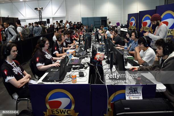 Video game players compete against each other at the Palais des Congres in Bordeaux during the eSports World Convention Summer edition on July 2 2017...
