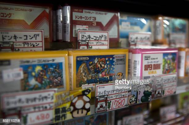 Video games cartridges for the Nintendo Co Nintendo Entertainment System /Famicom console are displayed for sale at the Super Potato video game store...