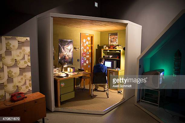 A video gaming fan play games in a rebuilt 80s' children's room at the Computer Game Museum during the International Games Week Berlin trade fair on...
