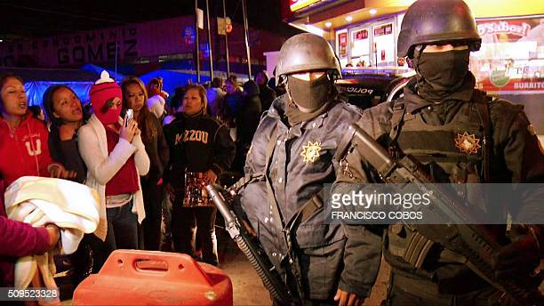 Video grab showing riot police and relatives of inmates of a prison in the northern city of Monterrey in Mexico on February 11 2016 At least 30...