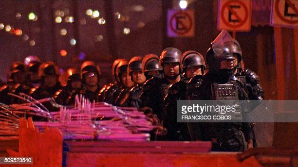 Video grab showing riot police officers deployed outside a prison in the northern city of Monterrey in Mexico on February 11 2016 where according to...