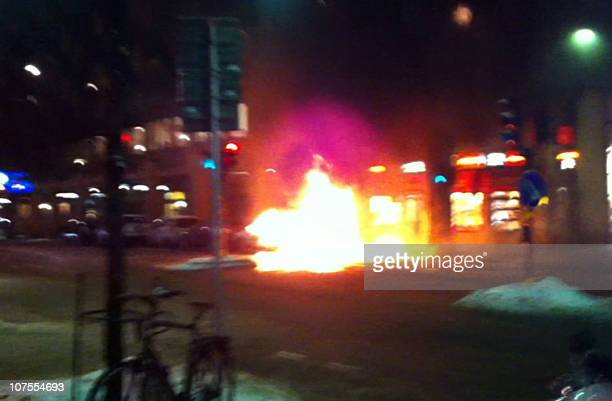A video grab shows a car in flames prior to exploding on December 11 2010 in Stockholm Taymour Abdel Wahab the suicide bomber behind twin weekend...