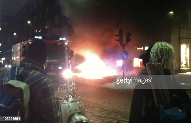 A video grab shows a fire engine arriving at the scene of a car explosion on December 11 2010 in Stockholm Taymour Abdel Wahab the suicide bomber...