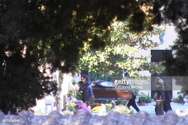 TOPSHOT A video grab shows relatives of mafia boss Toto Riina walking behind his coffin during the funeral on November 22 2017 at the Corleone...