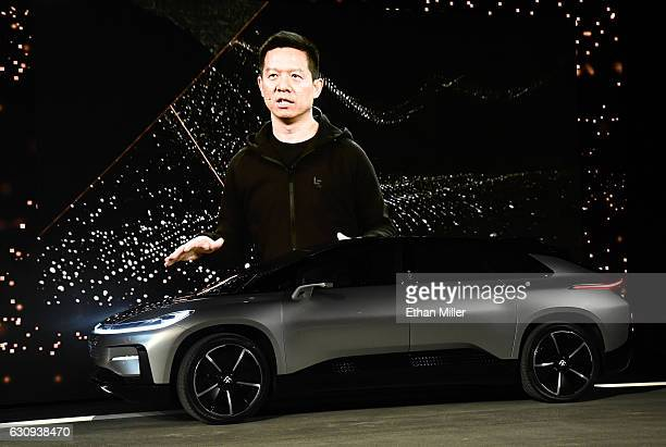 A video image of LeEco Founder and CEO YT Jia is shown as he unveils Faraday Future's FF 91 prototype electric crossover vehicle during a press event...