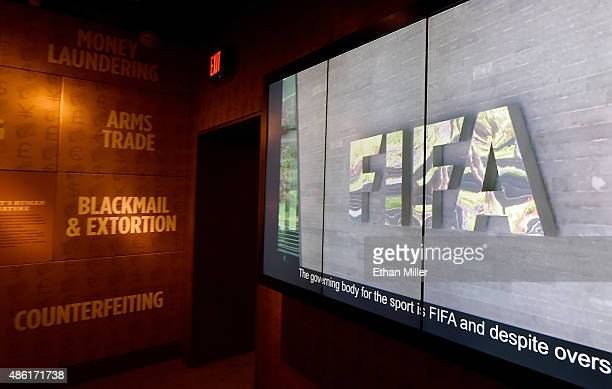 A video is shown during the unveiling of 'The 'Beautiful Game' Turns Ugly' a display at The Mob Museum chronicling the FIFA corruption scandal on...
