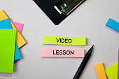 Video Lesson text on sticky notes with office desk concept