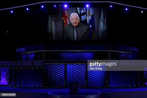 A video message from former US President Jimmy Carter is displayed on the second day of the Democratic National Convention at the Wells Fargo Center...