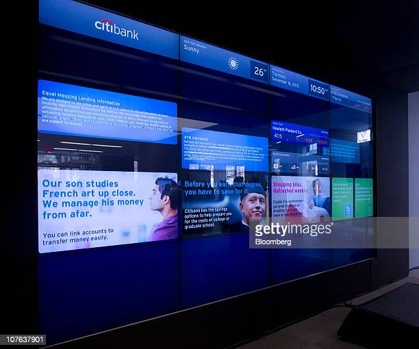 A video monitor displays information during the grand opening of Citigroup Inc's flagship Citibank branch in New York US on Thursday Dec 16 2010 The...
