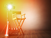Video, movie, cinema concept.  ?lapperboard and director chair. Film industry 3d illustration