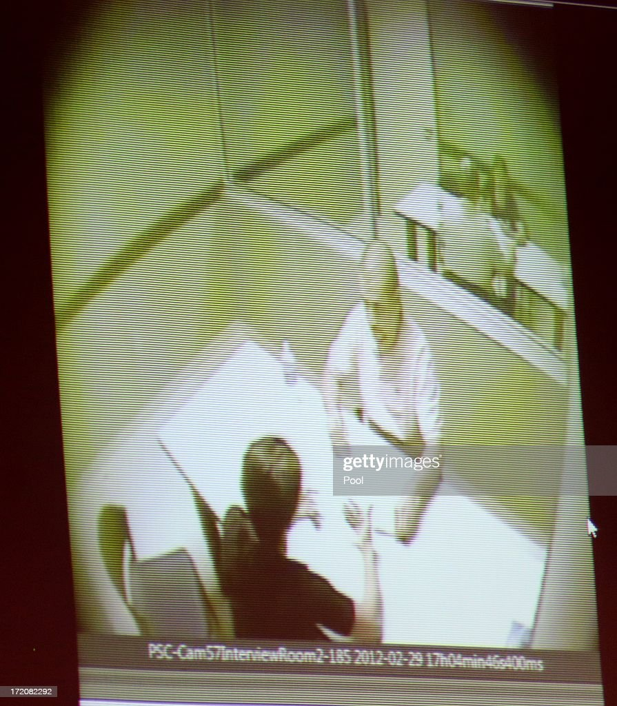 A video of George Zimmerman being interviewed at the Sanford police station is projected for the jury during the 16th day of his trial in Seminole circuit court July 1, 2013 in Sanford, Florida. Zimmerman is charged with second-degree murder for the February 2012 shooting death of 17-year-old Trayvon Martin.