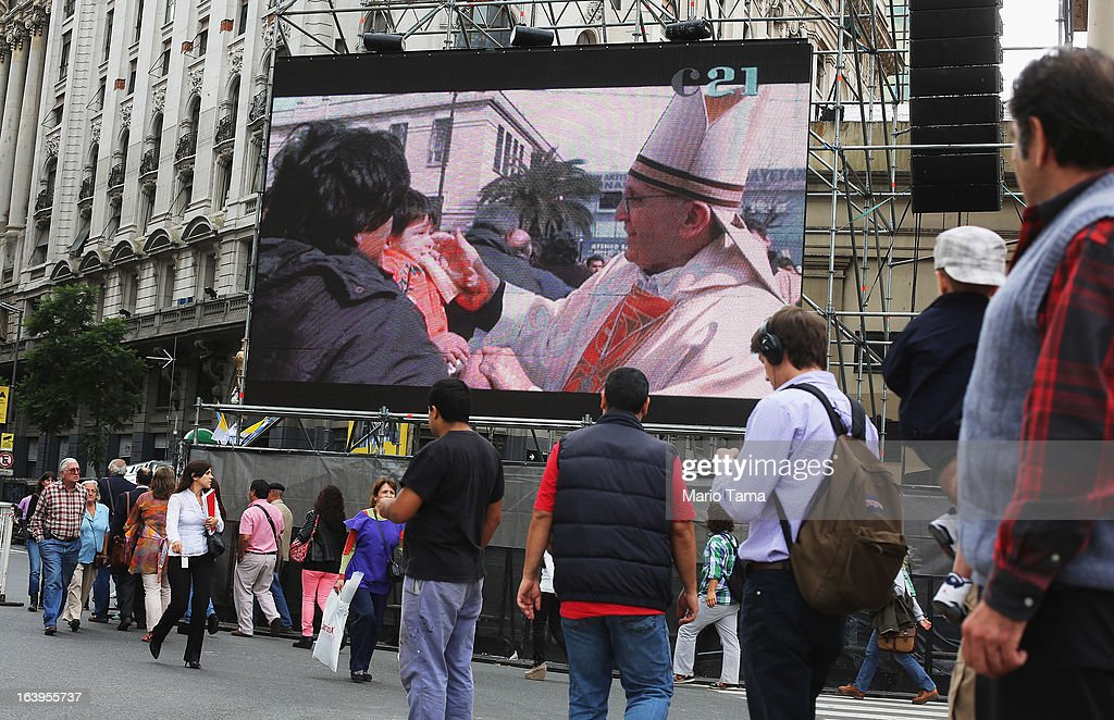 A video of <a gi-track='captionPersonalityLinkClicked' href=/galleries/search?phrase=Pope+Francis&family=editorial&specificpeople=2499404 ng-click='$event.stopPropagation()'>Pope Francis</a> is broadcast next to the Metropolitan Cathedral on March 18, 2013 in Buenos Aires, Argentina. Francis was the archbishop of Buenos Aires and is the first Pope to hail from South America. Francis will be officially installed as Pope tomorrow at Saint Peter's Square and the event will be broadcast live on the screen for Buenos Aires residents.