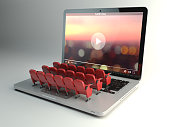 Video player app  or home cinema concept. Laptop and rows of cinema seats, 3d illustration