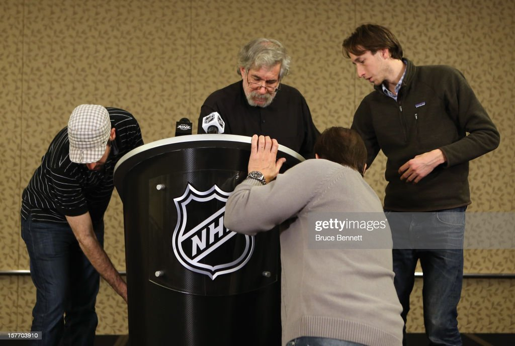 Video production crews move quickly to wire the newly arrived NHL podium for an upcoming press conference following a day of negotiations between the NHL and the Players Association at the Westin Times Square on December 5, 2012 in New York City.