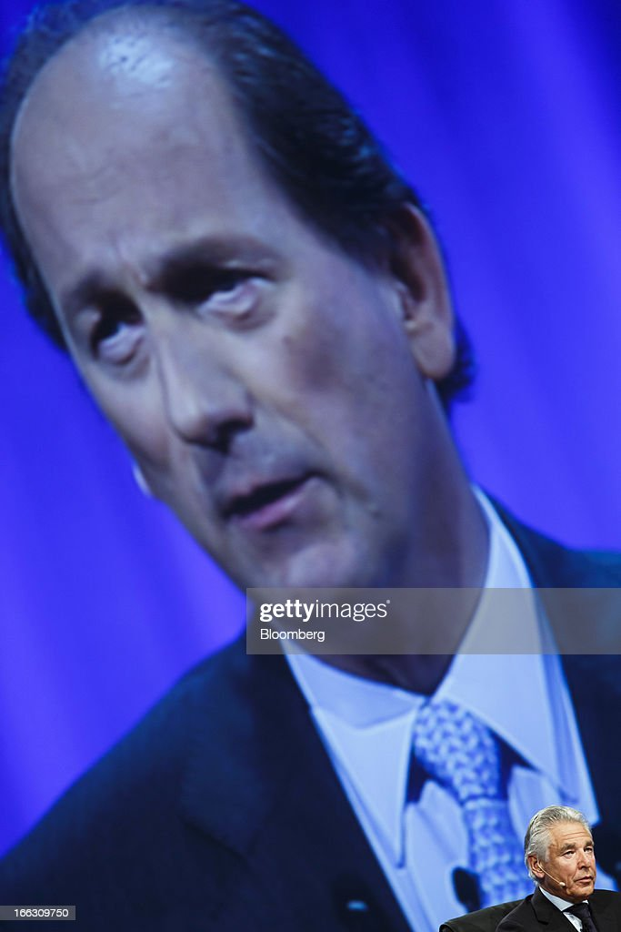 A video screen displays an image of Paul Bulcke, chief executive officer of Nestle SA, as Peter Brabeck-Letmathe, chairman of Nestle SA, right, speaks during the company's annual general meeting (AGM) in Lausanne, Switzerland, on Thursday, April 11, 2012. Nestle SA's chairman said Switzerland is becoming more difficult as a business location after voters last month approved some of the world's toughest limits on executives' pay. Photographer: Valentin Flauraud/Bloomberg via Getty Images