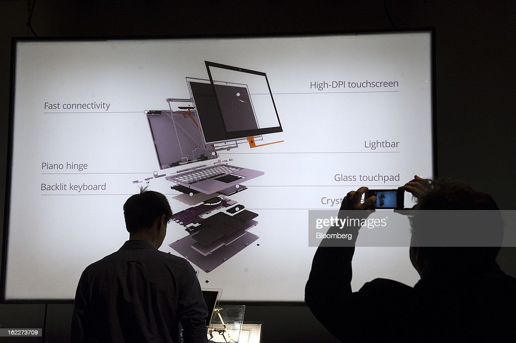 A video screen displays information about the features of Google Inc.'s new Chromebook Pixel laptop during a launch event in San Francisco, California, U.S., on Thursday, Feb. 21, 2013. Google Inc., owner of the world's most popular search engine, debuted a touchscreen version of the Chromebook laptop, stepping up its challenge to Microsoft Corp. and Apple Inc. in hardware. Photographer: David Paul Morris/Bloomberg via Getty Images