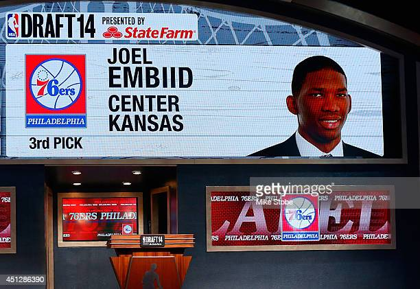 A video screen shows the selection of Joel Embiid of Kansas as the overall pick in the first round by the Philadelphia 76ers during the 2014 NBA...