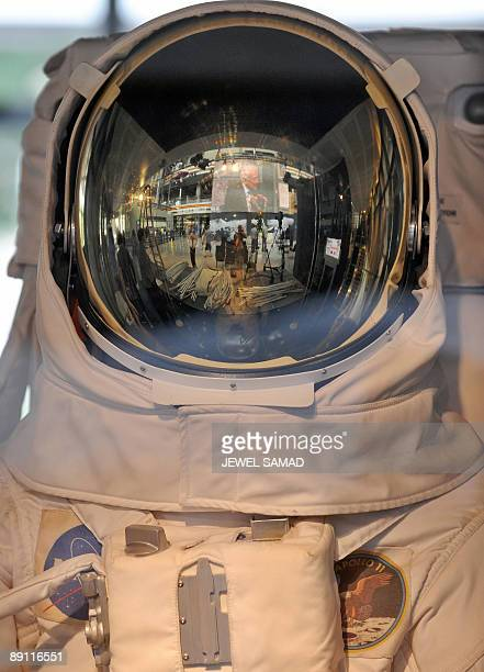 A video screen telecasting Edwin 'Buzz' Aldrin Lunar Module pilot of Apollo 11 speaking during a discussion on 'The Apollo Legacy The Moon and...