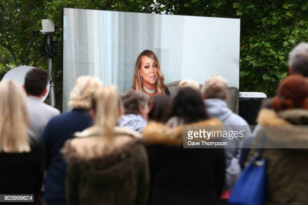 A video tribute from singer Mariah Carey is played during the funeral of Martyn Hett at Stockport Town Hall on June 30 2017 in Stockport England 29...