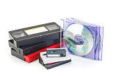 Video cassettes and CD or DVD conversion concept.