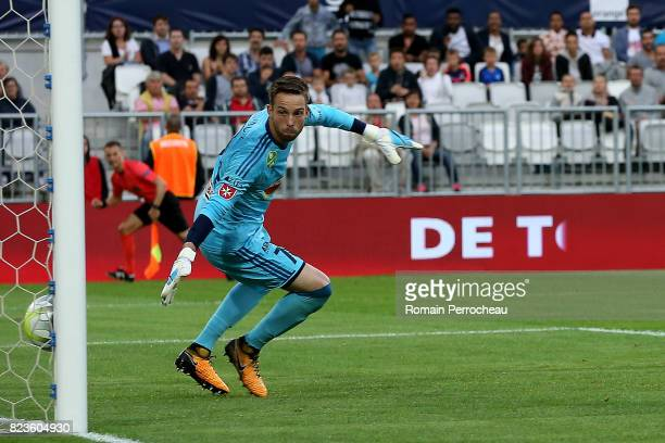 Videoton's goalkeeper Adam Kovacsik looks the ball enter in the goal during the UEFA Europa League qualifying match between Bordeaux and Videoton at...