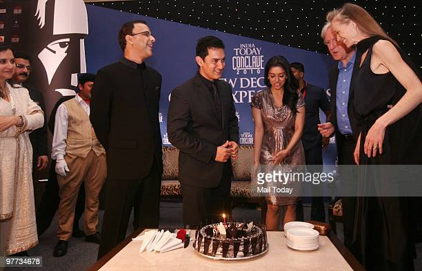 Vidhu Vinod Chopra Aamir Khan Asin and James Cameroon with his wife Suzy Amis get ready to cut Aamir's birthday cake at the dinner party hosted after...