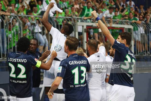 Vieirinha and team mates of Wolfsburg celebrate their team's first goal with the fans during the Bundesliga Playoff leg 2 match between Eintracht...