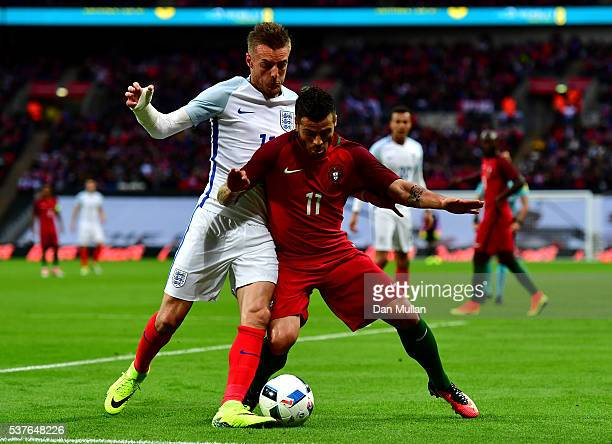 Vieirinha of Portugal and Jamie Vardy of England battle for the ball during the international friendly match between England and Portugal at Wembley...