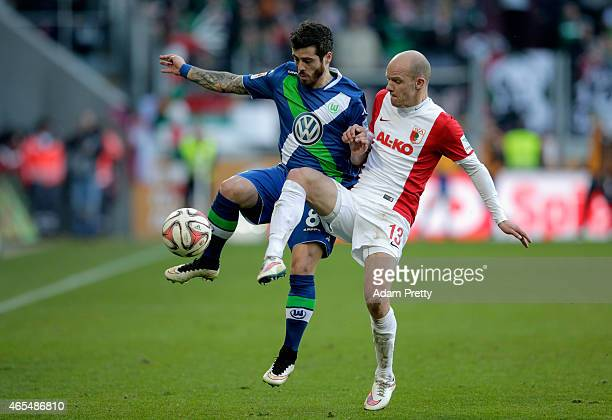 Vieirinha of VfL Wolfsburg and Tobias Werner of FC Augsburg battle for the ball during the Bundesliga match between FC Augsburg and VfL Wolfsburg at...