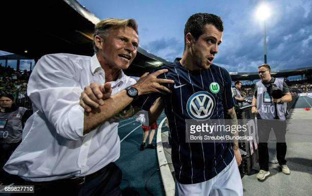 Vieirinha of VfL Wolfsburg celebrates with head coach Andries Jonker of VfL Wolfsburg after scoring his team's first goal during the Bundesliga...