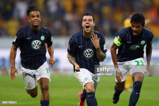 Vieirinha of Wolfsburg celebrates his team's first goal with team mates during the Bundesliga Playoff leg 2 match between Eintracht Braunschweig and...