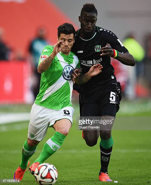 Vieirinha of Wolfsburg is challenged by Salif Sané of Hannover during the Bundesliga match between VfL Wolfsburg and Hannover 96 at Volkswagen Arena...
