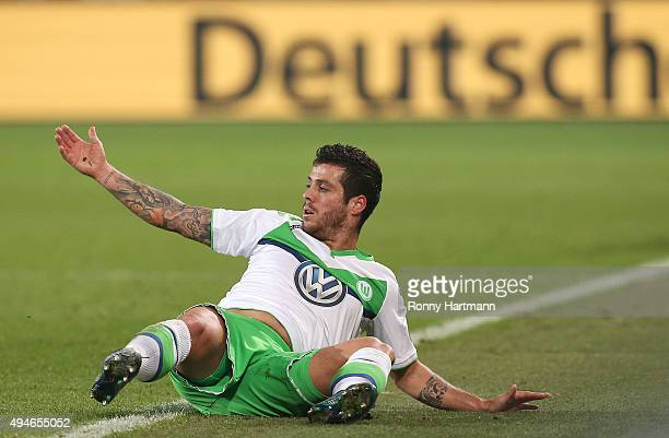 Vieirinha of Wolfsburg lies on the pitch during the DFB Cup second round match between VfL Wolfsburg and FC Bayern Muenchen at Volkswagen Arena on...