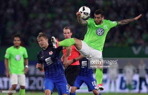Vieirinha of Wolfsburg vies with Jan Hochscheidt of Braunschweig during the Bundesliga Playoff first leg match between VfL Wolfsburg and Eintracht...